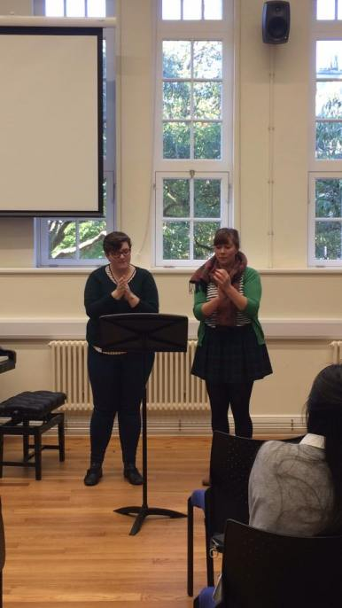 Charlotte Danford and Christina Homer perform Clapping Music by Steve Reich